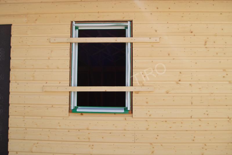 Pose des fen tres au ras avec le bardage maison ossature - Poser une fenetre bois ...